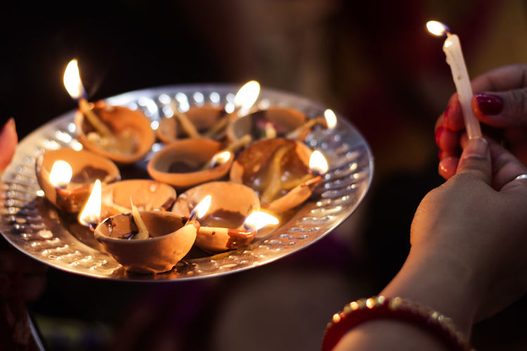 Diwali Lamp Lighting. Let the darkness go away Diya - Oil Lamp Dipawali Burning Fire Flame Fire - Natural Phenomenon Candle Human Body Part Human Hand Heat - Temperature Hand Illuminated One Person Indoors  Selective Focus Food And Drink Nature Food Spirituality Lifestyles Religion Tea Light