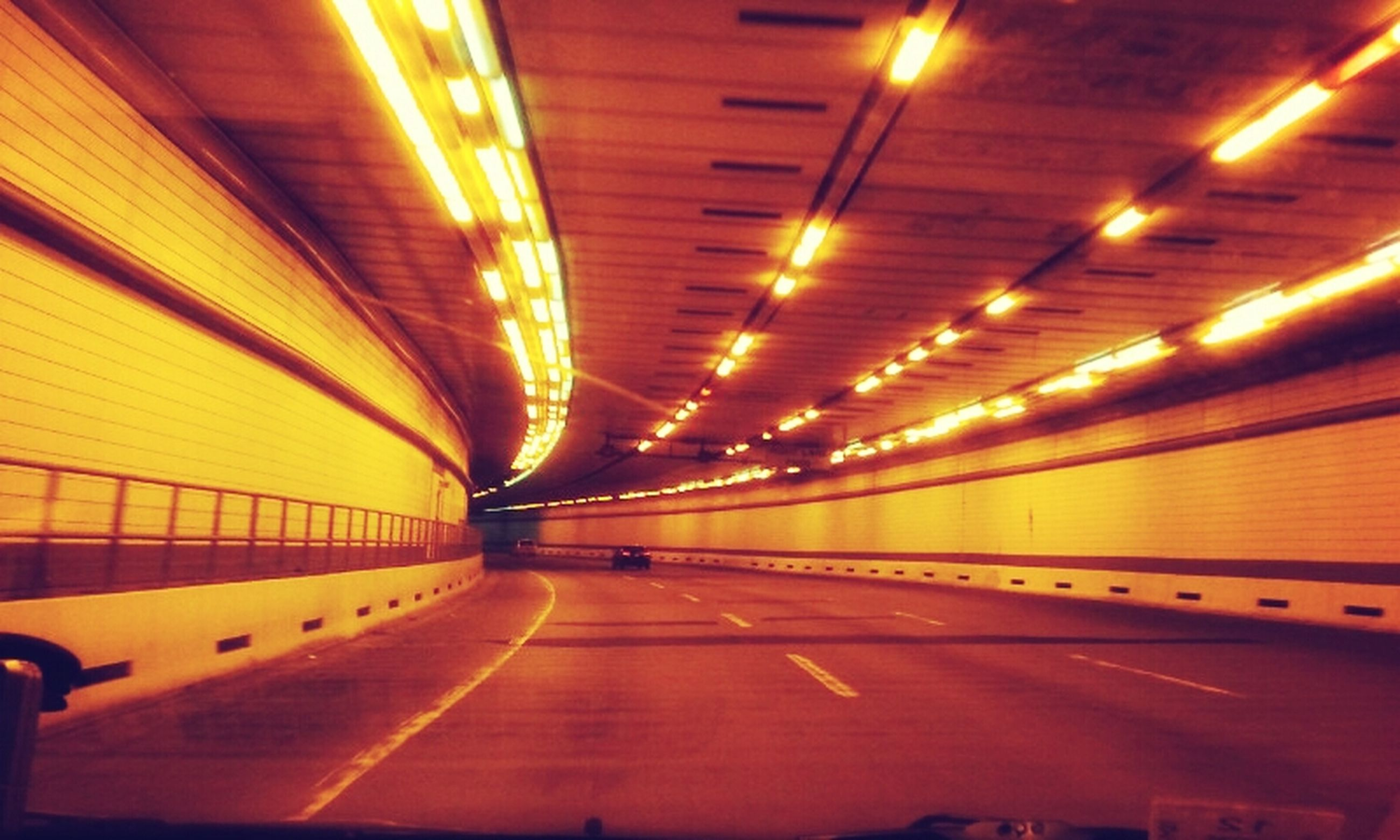 illuminated, indoors, the way forward, lighting equipment, transportation, diminishing perspective, night, architecture, ceiling, built structure, vanishing point, light - natural phenomenon, tunnel, empty, glowing, yellow, pattern, electric light, no people, orange color