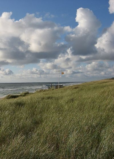 summer on sylt, beach scenery Dunes Wave Beach Beauty In Nature Cloud - Sky Clouds Day Field Flag Grass Horizon Over Water Landscape Nature Northsea Outdoors Rantum Scenics Sea Shore Sky Summer Sylt Tranquil Scene Tranquility Water The Week On EyeEm Been There.