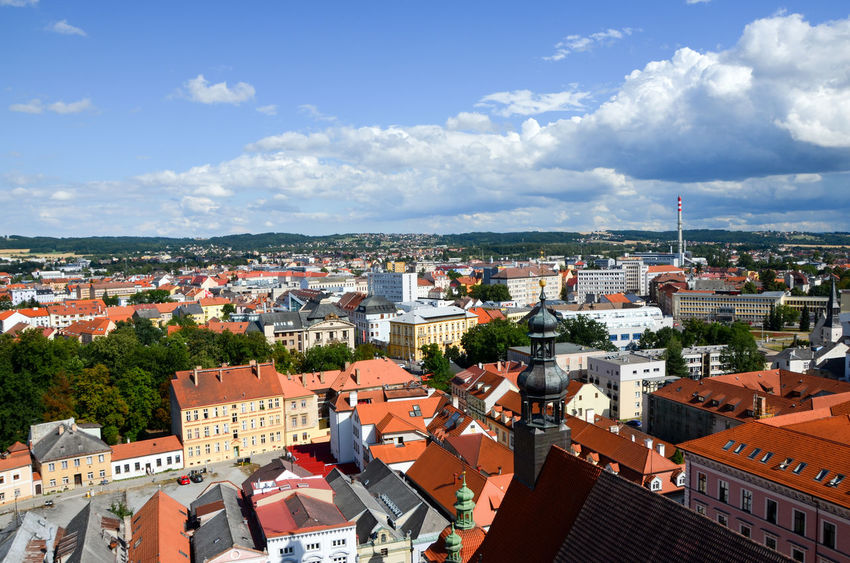 View of city of Ceske Budejovice Chimney Architecture Building Exterior Built Structure City Cityscape Cloud - Sky Community Crowded Day High Angle View Outdoors Residential Building Residential District Roof Rooftops Sky Sunlight Tiled Roof  Town Tree