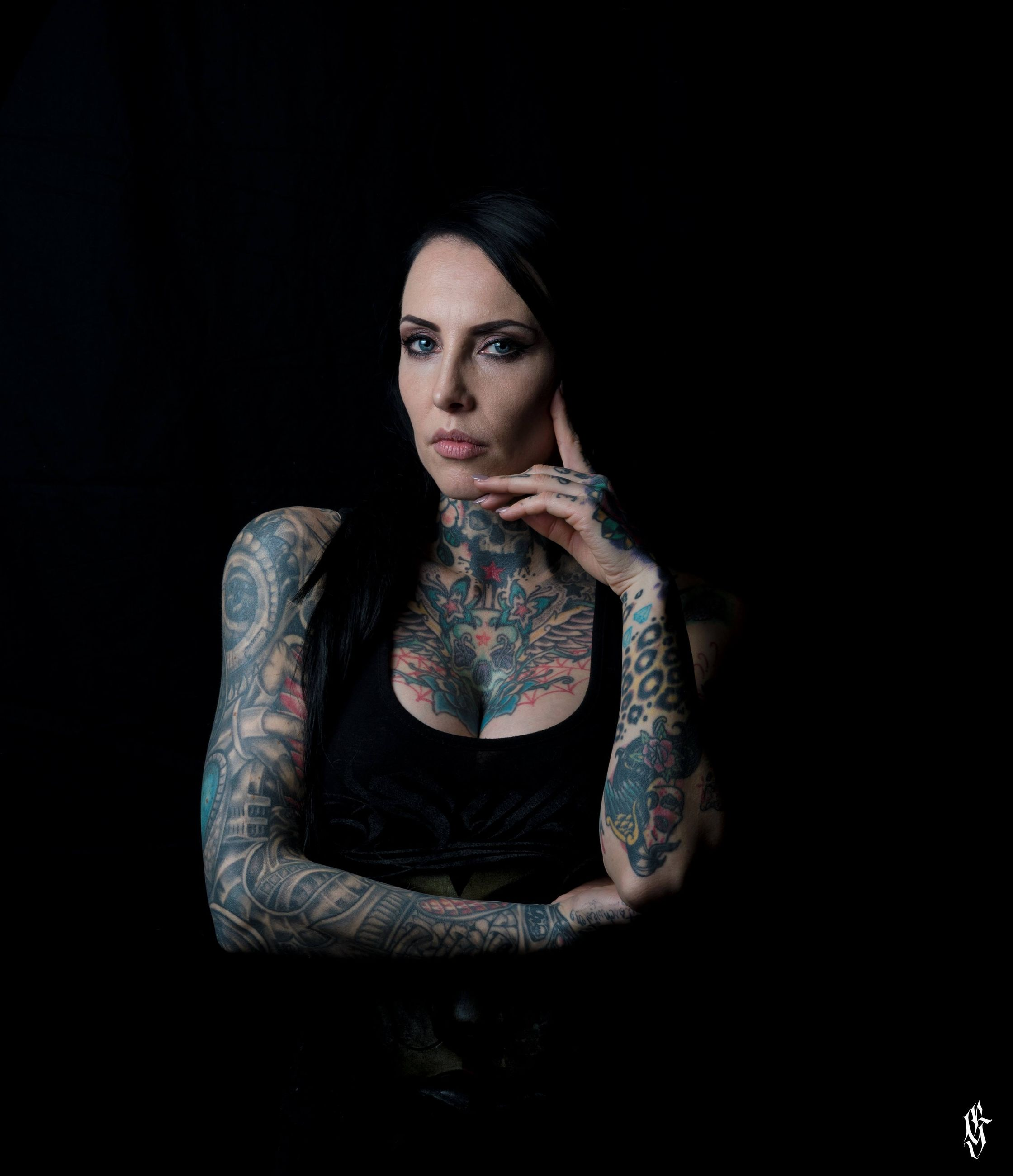 one person, studio shot, black background, front view, tattoo, looking at camera, indoors, young adult, portrait, adult, cut out, lifestyles, women, fashion, waist up, young women, casual clothing, standing, beautiful woman, dark, contemplation, hairstyle