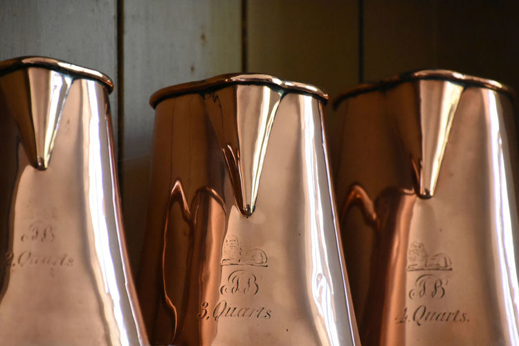 Close-up Copper  Day Engraved Handwriting  Indoors  Jugs Measurement Measuring Jug Metal No People Polished Surface Reflective Surface Text Three