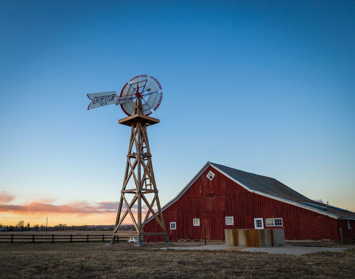 A small farm in Parker Colorado at sunrise. Blue Hour Clear Sky Farm Morning Windmill Alternative Energy Architecture Blue Building Exterior Built Structure Clear Sky Dawn Day Field Nature No People Outdoors Rural Scene Sky Sunrise Sunset Traditional Windmill Wind Power Wind Turbine Windmill