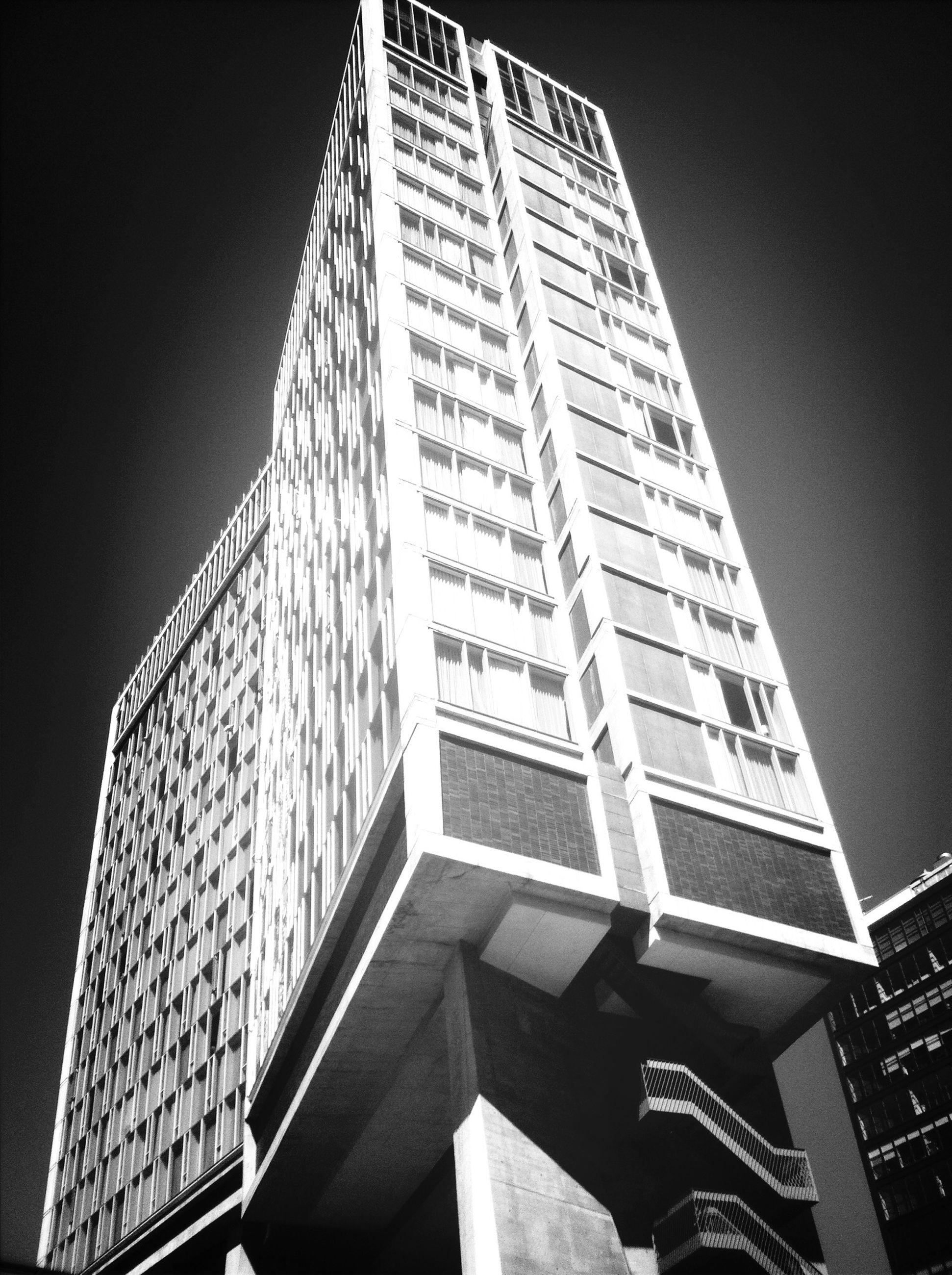 architecture, building exterior, built structure, low angle view, skyscraper, modern, city, tall - high, office building, tower, building, sky, tall, clear sky, outdoors, no people, day, window, city life