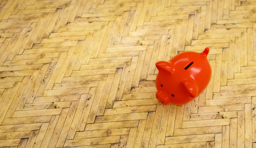 wooden floor with a red piggy bank - copyspace for your individual text. Wealth Wall Toy Still Life Single Object Single Security Secure Savings Save Safe Row Room Rich Representation Red Rate Profit Pink Piggybank Piggy Bank Piggy Pig Pattern Parquet Overweight No People Money Making Money Luxury Investment Invest Indoors  Individuality Idea House Building High Angle View Growth Growing Fund Floor Financial Finance Economic Divorce Deposit Copy Space Construction Concept Coin Bank Coin Close-up Cash Care Business Bigger Banking Bank Account Bank Art And Craft Animal Representation Animal Account