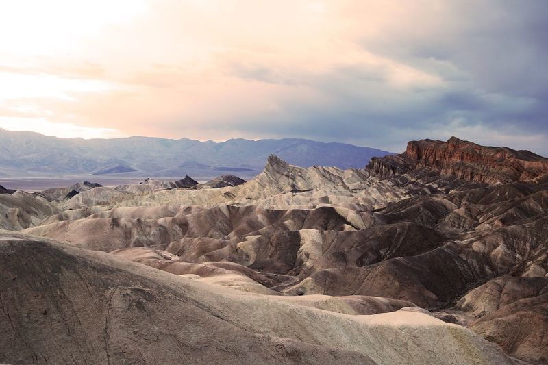 Scenic view of zabriskie point against cloudy sky at death valley national park