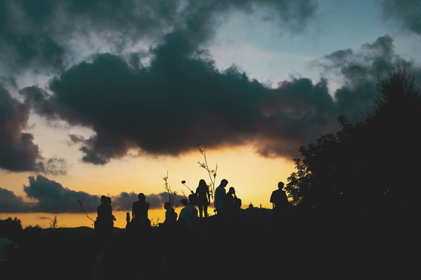 Beauty In Nature Cloud - Sky Crowd Group Of People Land Leisure Activity Lifestyles Men Nature Outdoors People Plant Real People Scenics - Nature Silhouette Sky Sunset Togetherness Tree