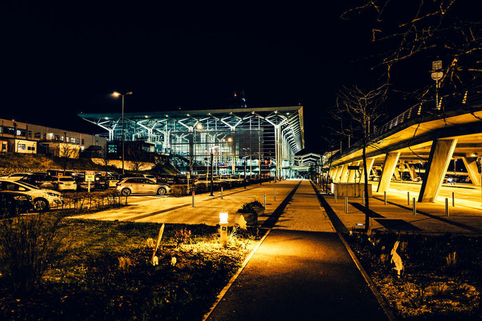 Architecture Basel Mulhouse Building Exterior Built Structure City Clear Sky Diminishing Perspective Empty Flughafen Flughafen Basel Footpath Illuminated Lighting Equipment Night Outdoors Road Street Street Light The Way Forward Transportation Tree Vanishing Point Walkway
