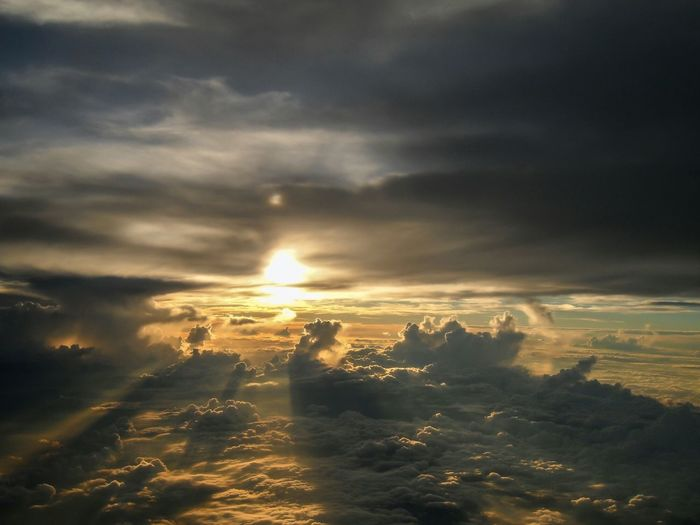 Edge Of The World Stormy Weather Sky And Clouds Skyscape Sky From An Airplane Window Airplane Clouds Sunset Sun Dog Sun Rays