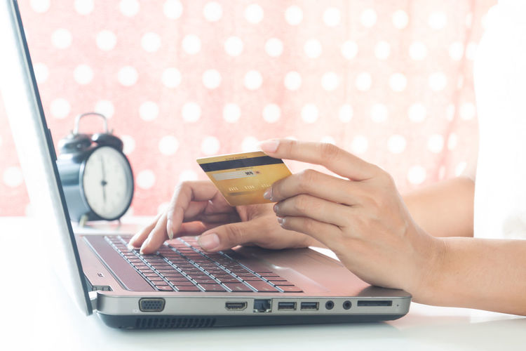 Hands using laptop and credit card. Smart technology. Online shopping Cart Cosmetic Beauty Plastic Cards Concept Entering E-commerce Cvv Ordering Wireless Tax Female Order Debit Smart Security Woman Typing RISK Information Data Lifestyle White Phone Ecommerce Keyboard Notebook Finance Electronic Internet Store Home Buy Technology Commerce Banking Using Purchase Business Pay Computer Shopping Laptop Hands Holding Payment Online  Card Credit
