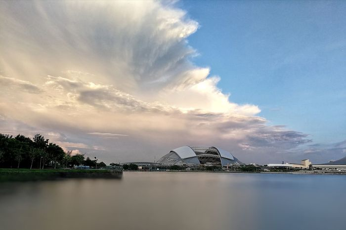 Looks like the windows of heaven are open Be. Ready. Cloud - Sky Outdoors Water Reflection No People Nature Built Structure Beauty In Nature at Kallang Basin Singapore National Stadium Travel Destinations Capture The Moment Scenics Architecture Cityscapes Blue Lake