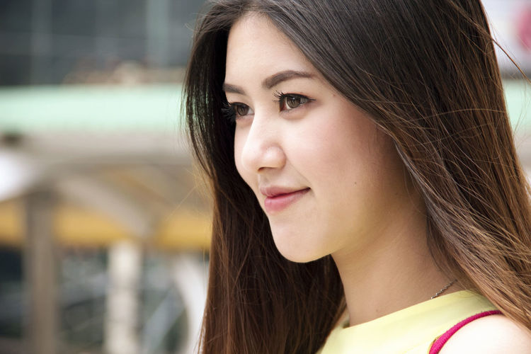 Side view of smiling young woman