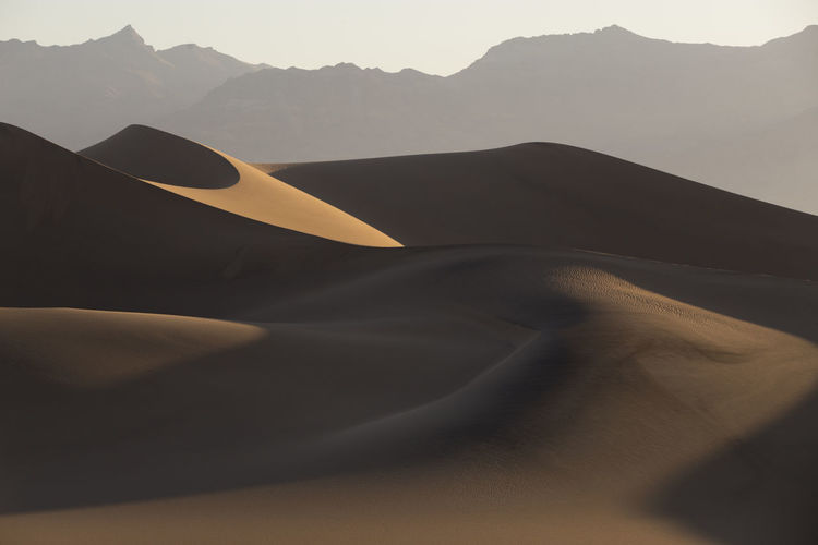 Desert Mountain Sand Dune Scenics - Nature Beauty In Nature Nature Landscape Tranquility No People Non-urban Scene Tranquil Scene Land Arid Climate Sand Environment Outdoors Climate Mountain Range Sky Day Isolation