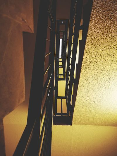 Looking up Tower Block  Flats High Rise vanishing point Looking Up Staircase EyeEm Gallery Urbanphotography High Newcastle Upon Tyne, Spiral Staircase Steps And Staircases Steps Staircase Architecture Built Structure Hand Rail Stairs Stairway Narrow Railing Fire Escape