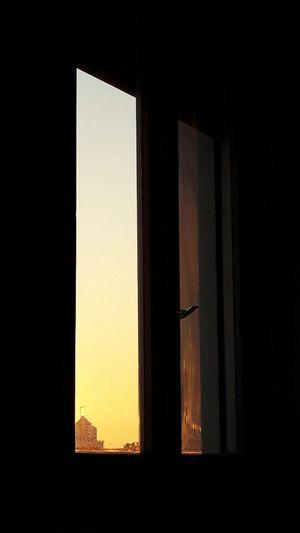 Urban sunset Indoors  Window No People Sunset Architecture Sunlight Day Sky Close-up EyeEm Selects EyeEmBestPics EyeEm Best Shots Architecture City EyeEm Light Contrast House Urban Urbanphotography City Life Sol Shadow Shadows & Lights