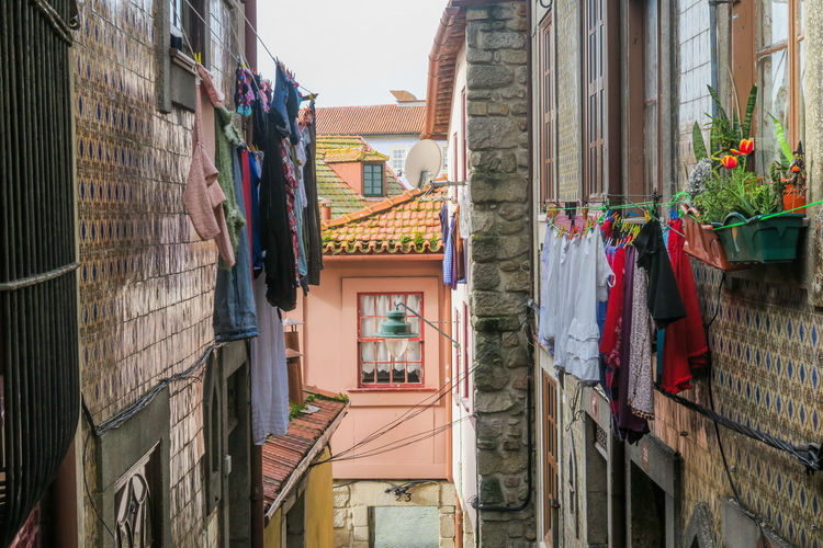 Laundry drying in an alley of the old town of porto, portugal Porto Laundry Drying Clothes Springtime Traditional Built Structure City Tradition Multi Colored Architecture Building Exterior Built Structure Sky