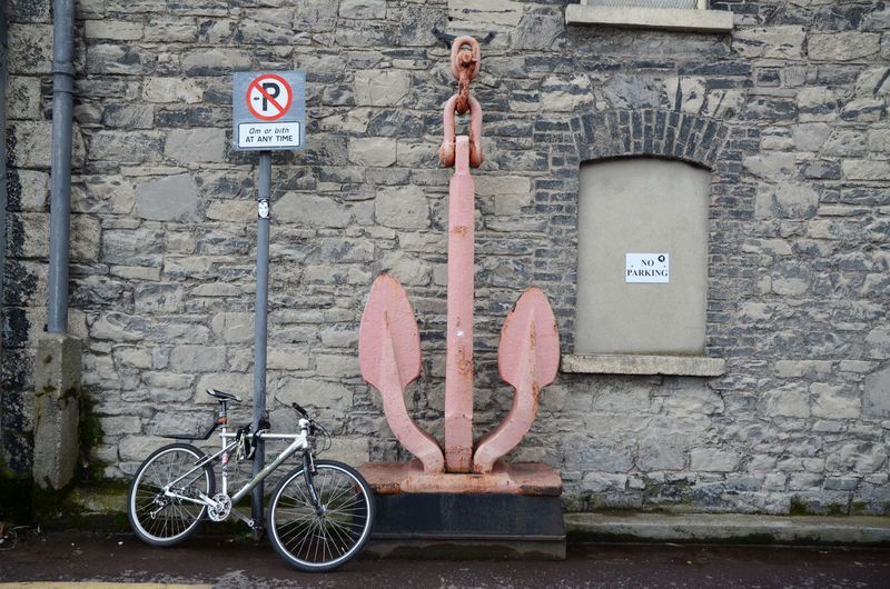 Bicycle attached to no parking sign