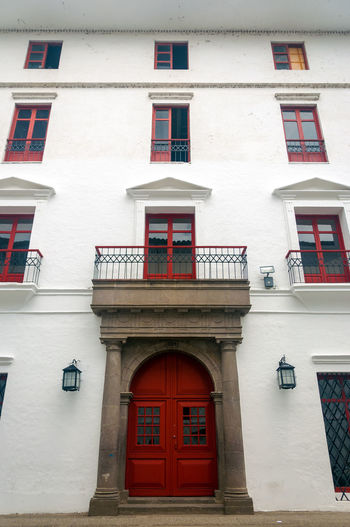 A red and white colonial building in Popayan, Colombia. America Architecture Architecture Balcony Beautiful Building City Colombia Colonial Day Door Exterior Façade Historic Latin Old Outdoors Popayán Red South Spanish Style Traditional Travel Window