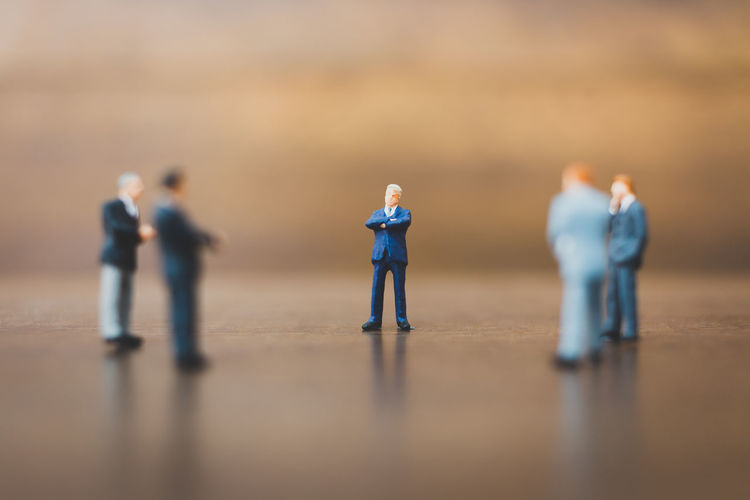 Action Background Business Businessman Closeup Dealer Entrepreneur Figure Leader Little Male Man Men Merchant Mini Miniature Operatorl People person Rich Small Space Suit Tiny Toy Trader Tradesman Tycoon Work