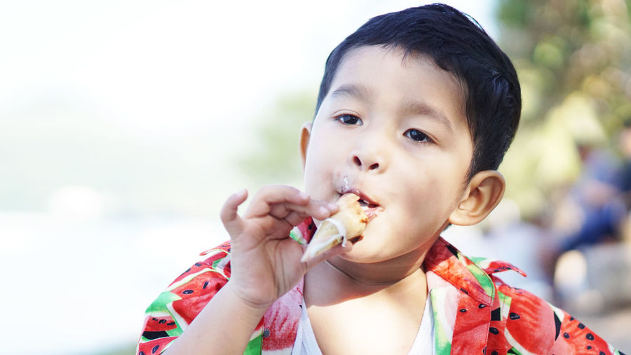 Portrait of cute boy eating food