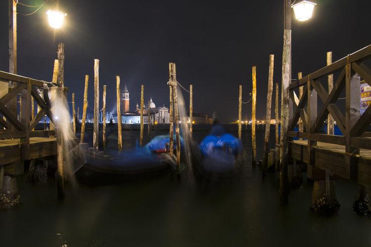 Gondolas at grand canal against sky at night