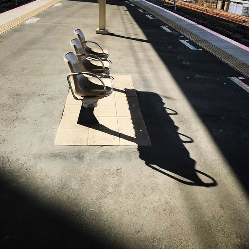 Railroad Station Bench Railroad Station Platform Shadow Sunlight High Angle View Day Transportation No People Outdoors