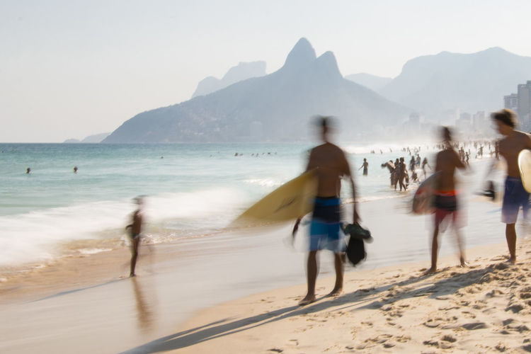 À la plage | Ipanema Beach capturing motion Beach Clear Sky Leisure Activity Mountain Mountain Range Outdoors Relax Sea Sunny Day Unrecognizable Person Vacations Water The Street Photographer - 2017 EyeEm Awards The Great Outdoors - 2017 EyeEm Awards