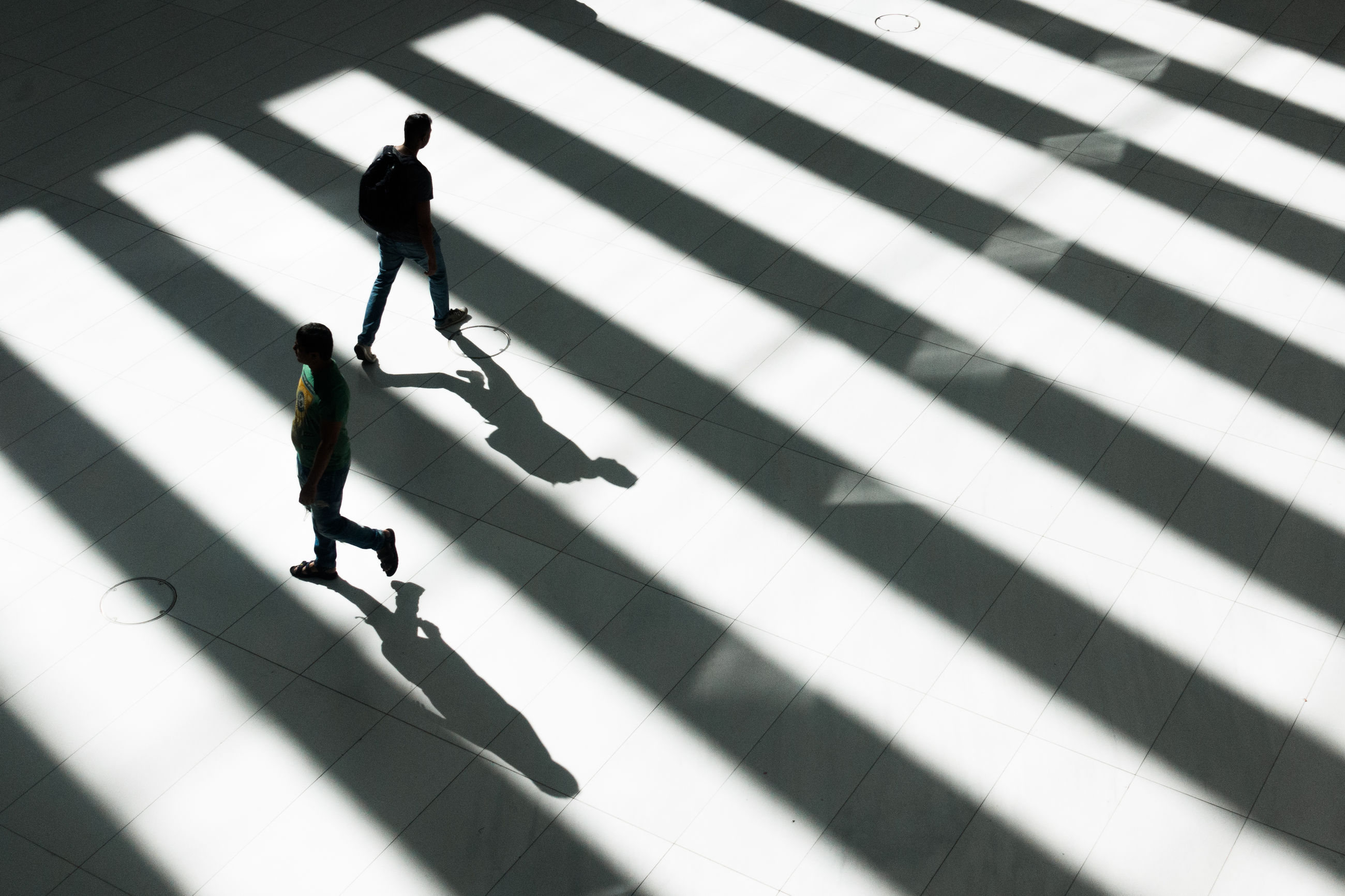 walking, shadow, full length, men, silhouette, two people, real people, day, togetherness, motion, urgency, lifestyles, businessman, women, outdoors, adult, city, people, only men, adults only