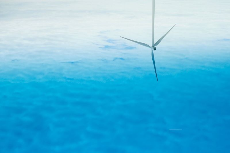 Water Wind Turbine Blue Wind Power Swimming Pool No People Windmill Day Full Frame Alternative Energy Industrial Windmill Tranquility Nature Outdoors Beauty In Nature Close-up Sky