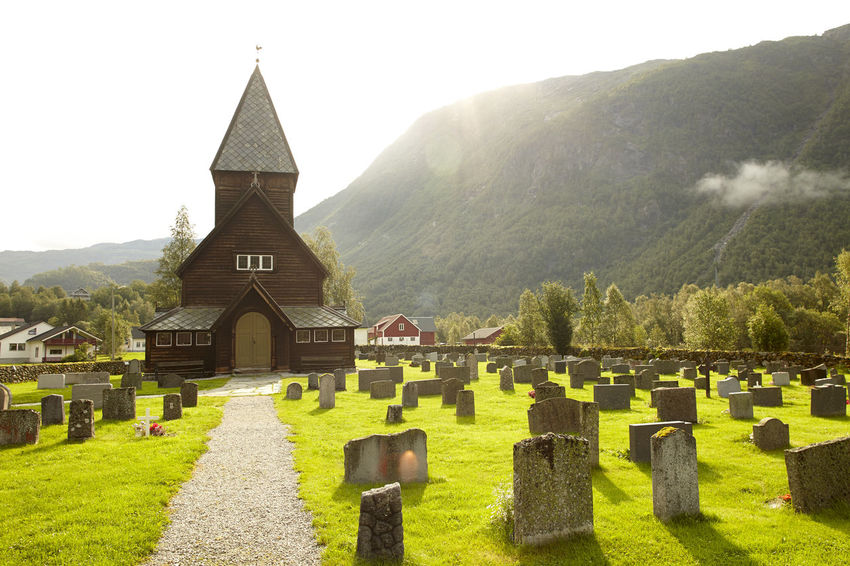 Røldal Stavkirke (Norway, Stave Church) Architecture Beauty In Nature Building Exterior Cemetery Church Clear Sky Cross Grass Grave Graveyard History Mountain Nature No People Norway Outdoors Place Of Worship Religion Røldal Scenics Sky Spirituality Stave Church Tranquility Tree