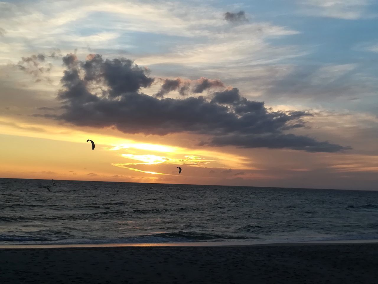 sky, sea, sunset, water, cloud - sky, horizon over water, scenics - nature, horizon, beauty in nature, beach, land, orange color, nature, tranquil scene, tranquility, sport, adventure, flying, mid-air, outdoors, kiteboarding, parasailing