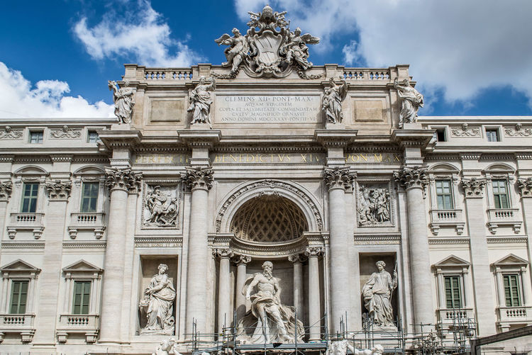 Trevi Fountain, Rome, Italy Rome Trevi Fountain Arch Architectural Column Architecture Art And Craft Building Exterior Built Structure City Cloud - Sky Creativity Day Female Likeness History Human Representation Male Likeness Nature No People Outdoors Representation Sculpture Sky Statue The Past Travel Destinations