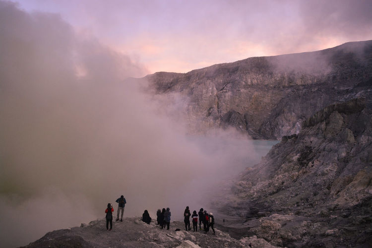 Sunrise at mount ijen and tourist