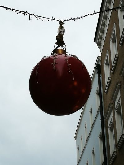 Low angle view of hanging light against sky