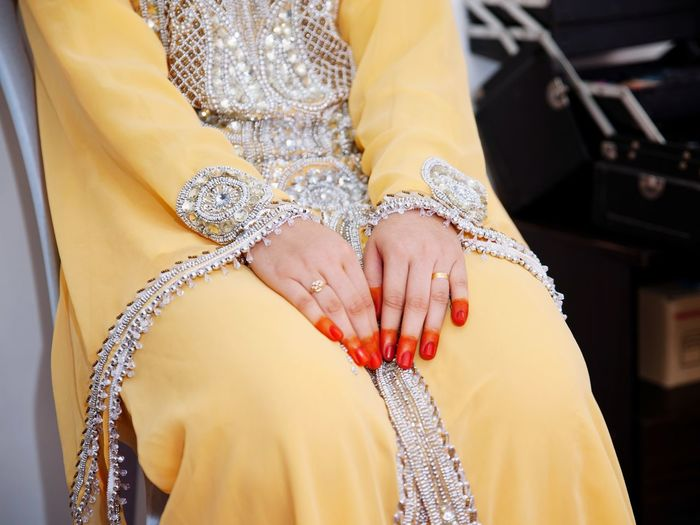Midsection of bride sitting during wedding ceremony