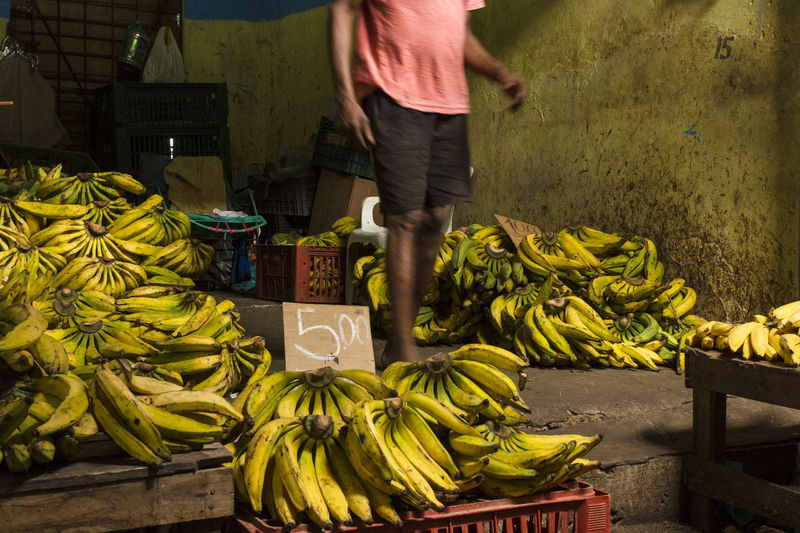 Low Angle View Paint The Town Yellow Street Vendor Street Market Adult Banana Feira De São Joaquim Food Fresh Food Freshness Fruit Healthy Eating Low Section Market One Person Streetphotography Vegetable Yellow
