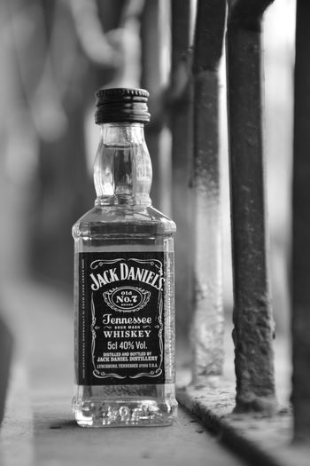 JACK DANIELS Alcohol Jack Daniels Blackandwhite Alcoholic Drink Alcohol Bottles Alcohol Old Jack Daniels Whiskey Whiskey Light And Shadow Jack Daniels Wiskey Wiskey Bottle Container Bottle Food And Drink Drink No People Text Refreshment Food Glass - Material Label Business Focus On Foreground