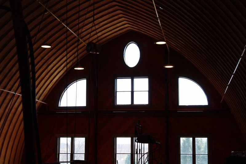 A beer barn in NY Indoors  Ceiling Window Arch Architecture Built Structure Low Angle View No People Barn Brewery Seneca SenecaLake New York Day Illuminated The Architect - 2017 EyeEm Awards Visual Feast