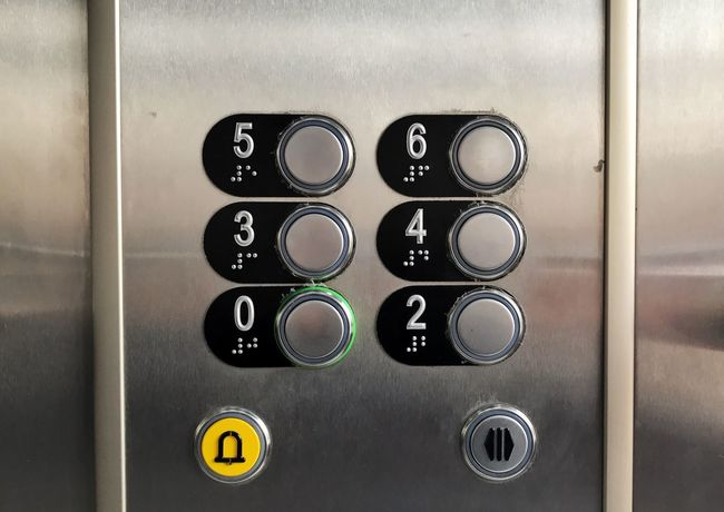 Elevator Communication No People Indoors  Technology Close-up Day Old Buttons Push Button Control Panel Sign Metal Silver Colored Elevator Indoors  Number Guidance Control In A Row Convenience Text Information Arrow Symbol