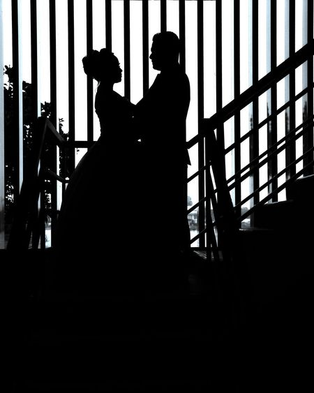 Silhouette people standing on staircase