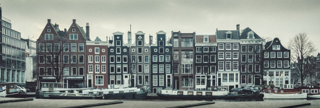 Langs de Amstel, tegenover Carré City Building Exterior Travel Destinations Architecture Cityscape Outdoors Built Structure No People Downtown District Cold Temperature Urban Skyline City Street Amsterdam Canal Winter House Boat Houseboat Old Buildings