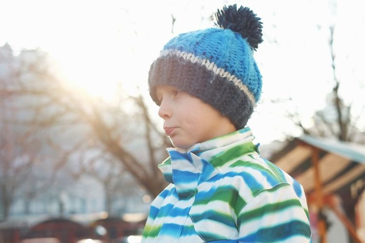 Boy and his woolen cap on a sunny winter day. Sun flares all over. Children Only One Boy Only Childhood Males  Headshot Child One Person Knit Hat Innocence People Day Outdoors Winter Warm Clothing Close-up Authentic Moments Sun Flares Eye4photography  This Week On Eyeem Portrait Hanging Out