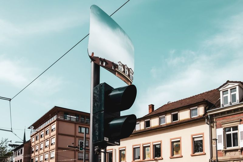Rückspiegel ... Urban Perspectives Street Photography Mirror Signal Building Exterior Architecture Sky Built Structure Cloud - Sky Low Angle View Building City Day No People Communication Outdoors Street Residential District Street Light Lighting Equipment Road Sign Pole The Devil's In The Detail The Street Photographer - 2019 EyeEm Awards The Architect - 2019 EyeEm Awards My Best Photo