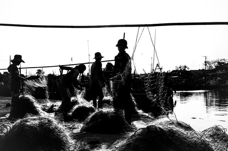 Fishing Net Blackandwhite Blurred Motion Clear Sky Day Flowing Water Group Of People Leisure Activity Lifestyles Long Exposure Men Motion Nature Outdoors People Real People Sea Sky Splashing Sport Standing Water Focus On The Story EyeEmNewHere