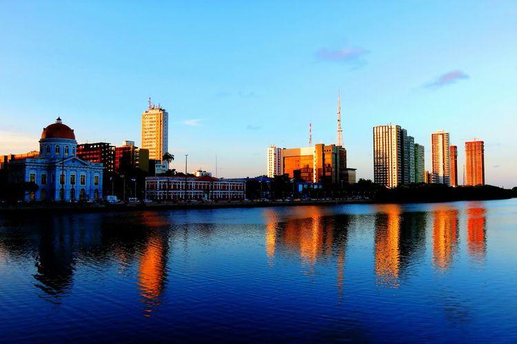 Sea And Buildings Against Blue Sky