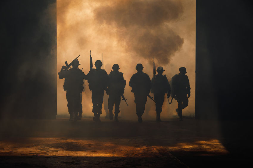 Teamwork Walking Around Architecture Crowd Full Length Government Group Of People Gun Control Men Night People Real People Rear View Silhouette Smoke - Physical Structure Soldiers Uniform Standing Togetherness War