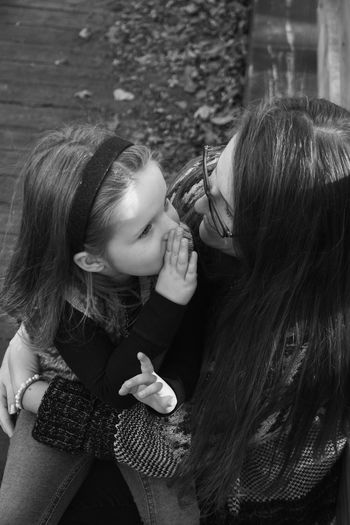 Secrets. Two People Love Young Women Women Togetherness Monochrome Beautiful People Lifestyles Black And White People Happiness Bonding Hair Smiling Girls Mother Girl Happiness Child Motherhood Childhood Close-up Portrait Photoshoot People In Places