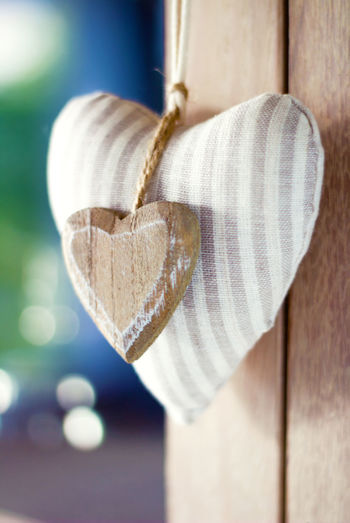 Close-up of heart shape hanging on wood