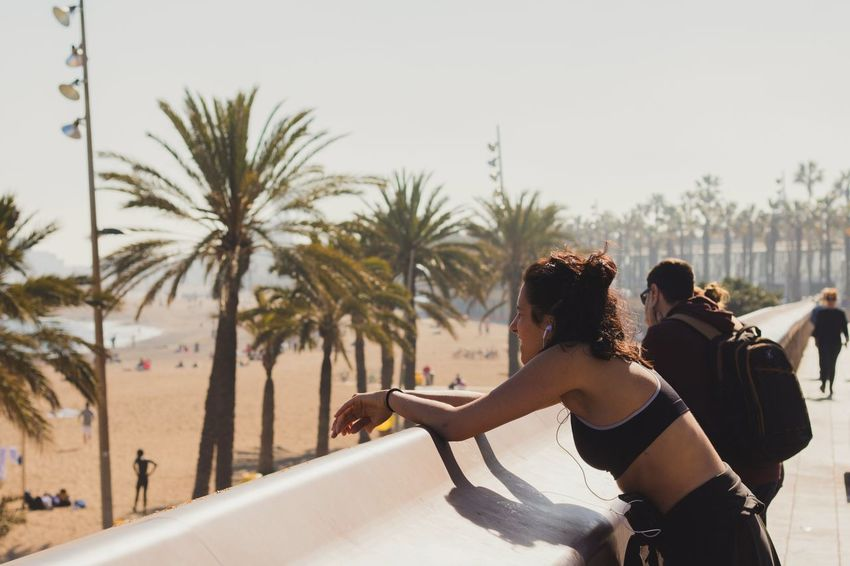 Two People Palm Tree Togetherness Young Adult Adults Only Vacations Rear View Young Women Happiness Outdoors Beach Swimming Pool Tree Adult Bonding Friendship People Day Human Body Part Enjoying Life Leisure Activity Sunlight Running Barcelona Portrait Of A City Resist EyeEm Diversity TCPM The Street Photographer - 2017 EyeEm Awards