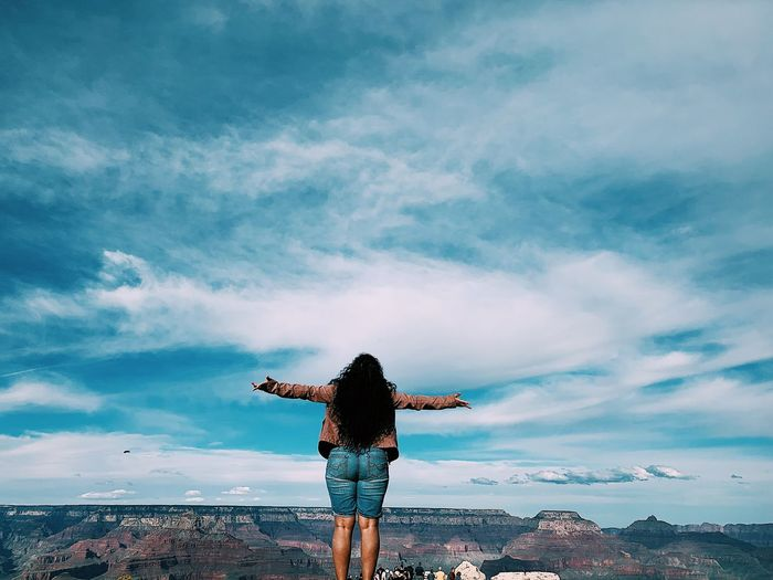 Freedom mind free and having fun and feeling happy Human Arm Arms Outstretched Sky Cloud - Sky Limb Rear View One Person Water Arms Raised Beauty In Nature Carefree Real People Nature Standing Leisure Activity Freedom Lifestyles Sea Outdoors Casual Clothing Exploring Fun
